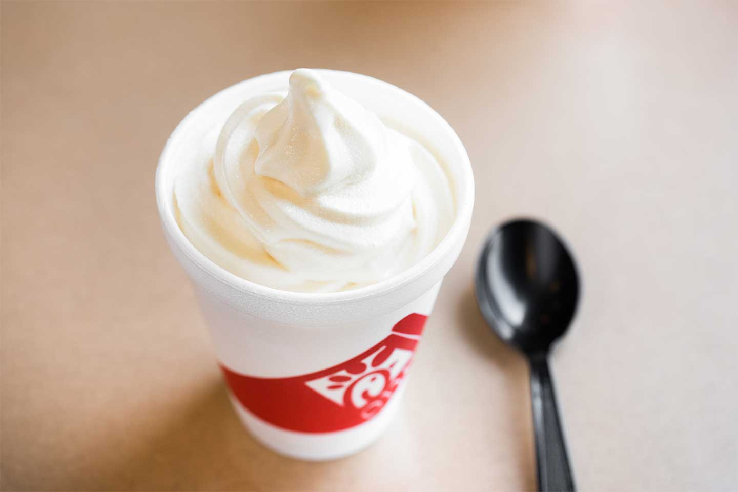 Chick-fil-A Vanilla Icedream cup with a black spoon